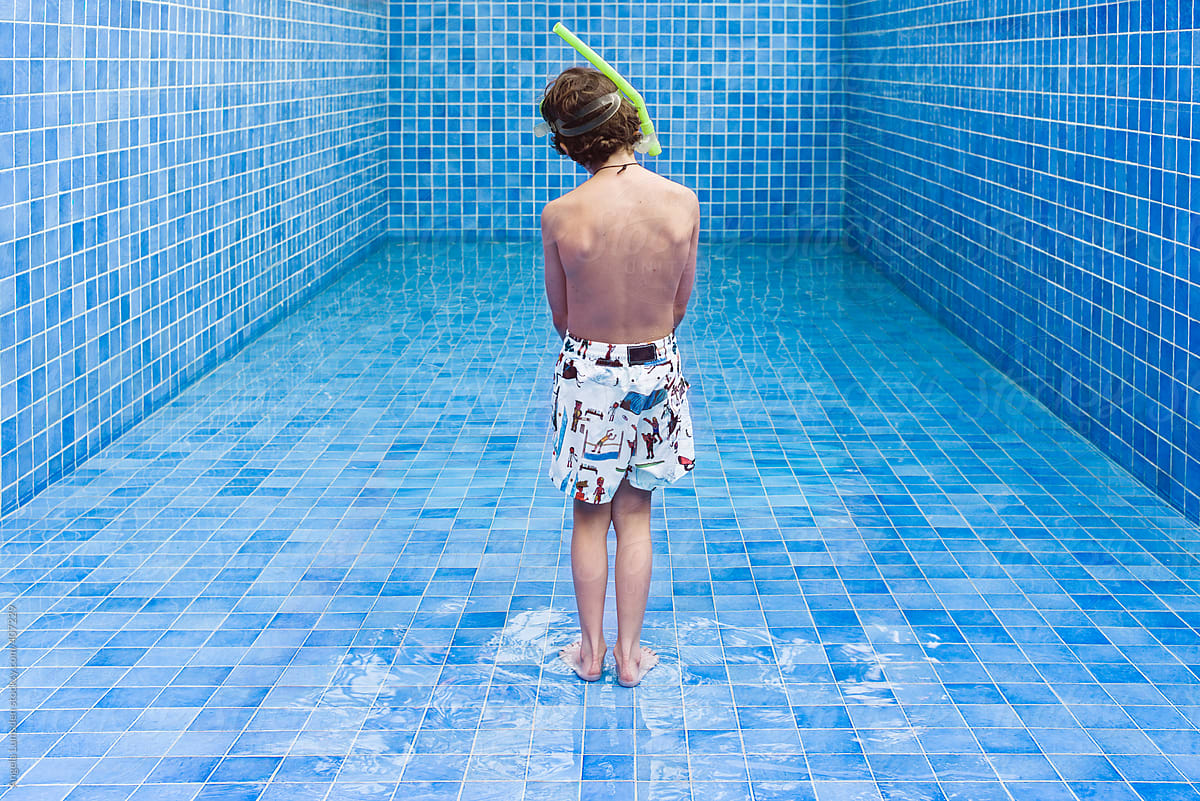 Stock Photo - Boy Stands In An Empty Blue Swimming Pool Waiting For The  Water Level To Rise