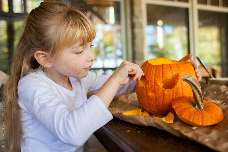 Little Girl Carving Halloween Pumpkin Jack-O-Lantern by JP Danko for Stocksy United