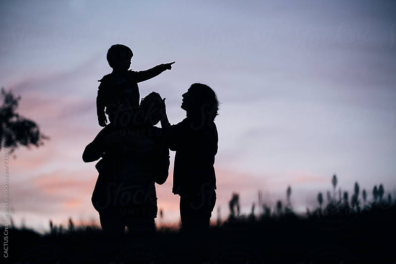 Family at sunset by CACTUS Blai Baules for Stocksy United