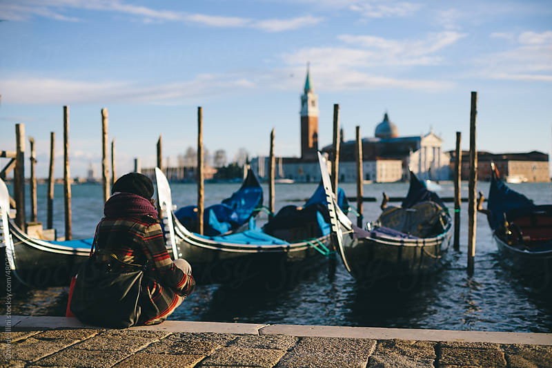 Young woman in St. Mark's Square in Venice by Davide Illini for Stocksy United