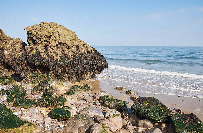 Coastal rock formations at low tide. Tenby, Wales, UK. by Liam Grant for Stocksy United