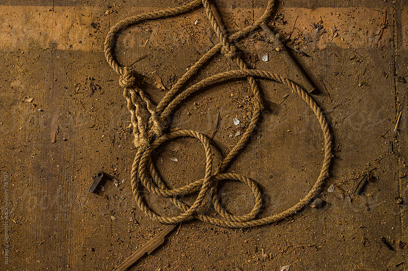 Old Rope on A Dirty Wooden Floor by suzanne clements for Stocksy United
