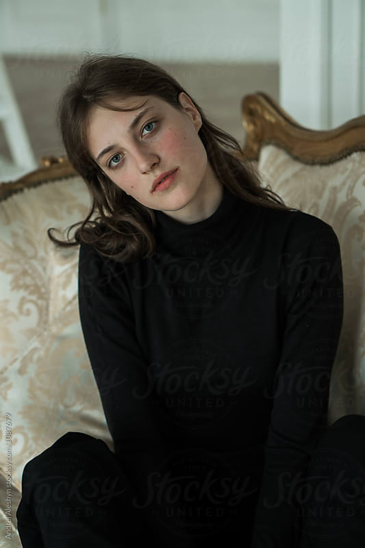 portrait of a beautiful girl on the couch by Andrei Aleshyn for Stocksy United