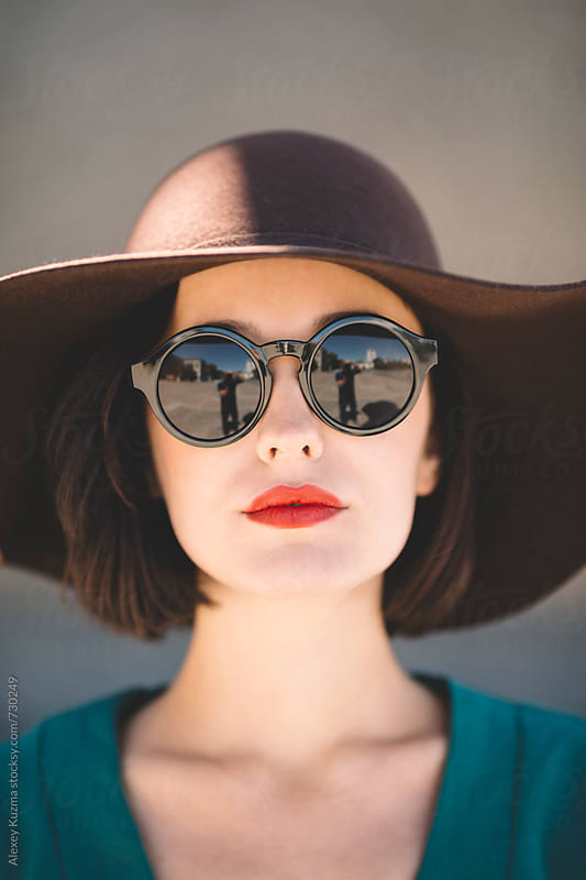 young woman wearing hat in closeup . by Alexey Kuzma for Stocksy United