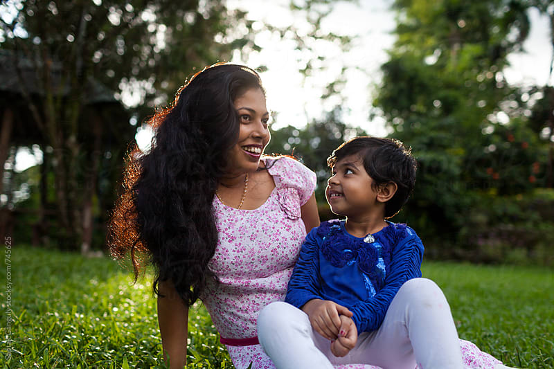 Little girl sharing cheerful moment with her mother by Saptak Ganguly for Stocksy United