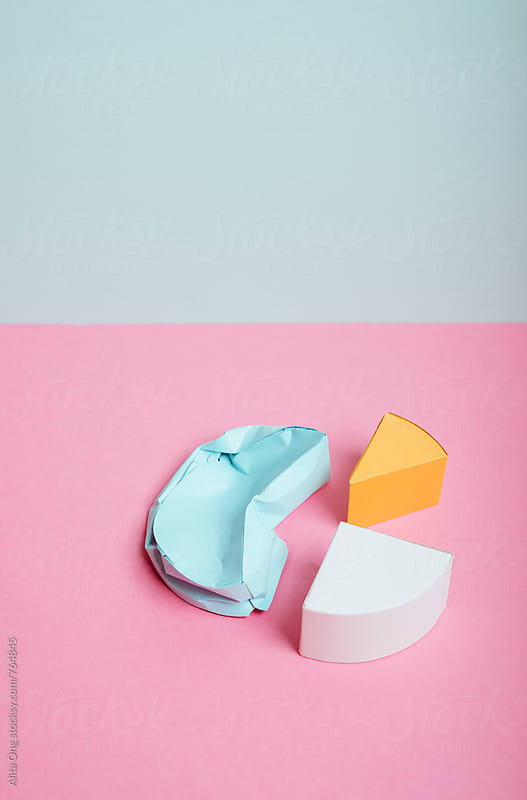 Crumpled pie chart by Alita Ong for Stocksy United