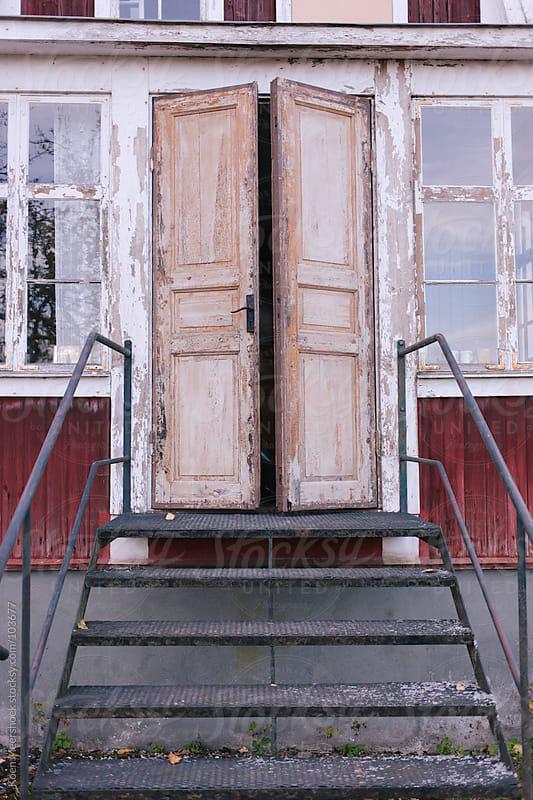 A stair to an old red house. by Koen Meershoek for Stocksy United