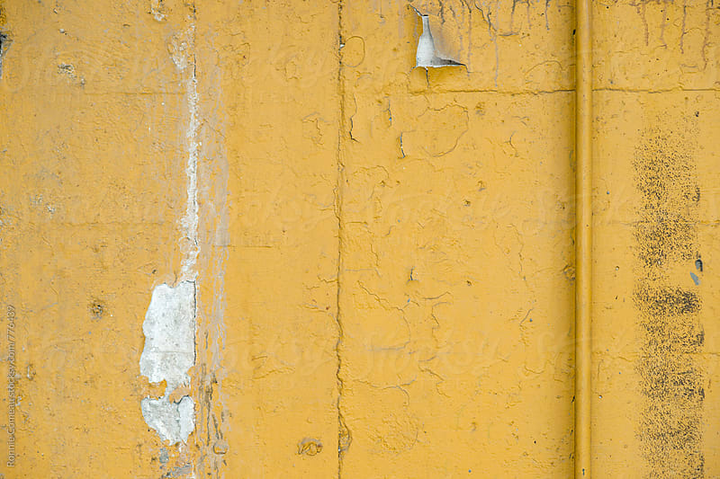 Rough Looking Yellow Wall by Ronnie Comeau for Stocksy United