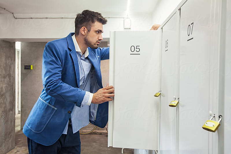 Businessman Putting His Belongings into a Locker by Lumina for Stocksy United