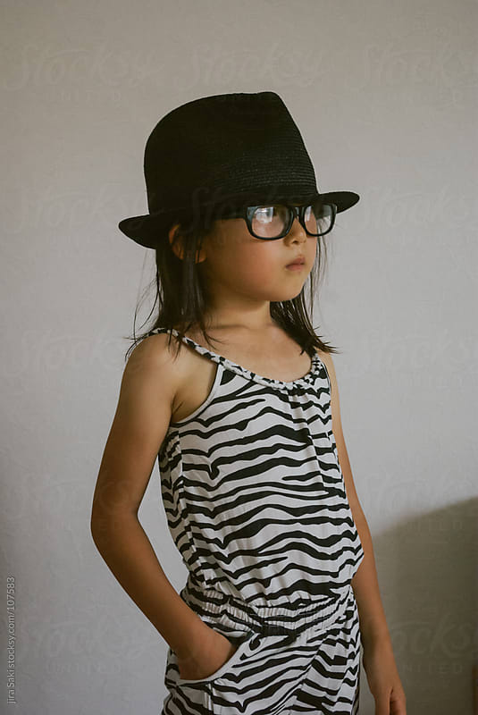 posing girl by jira Saki for Stocksy United