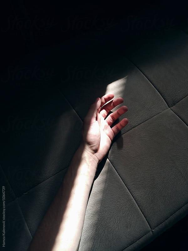 Shadows on hand by Hamza Kulenović for Stocksy United