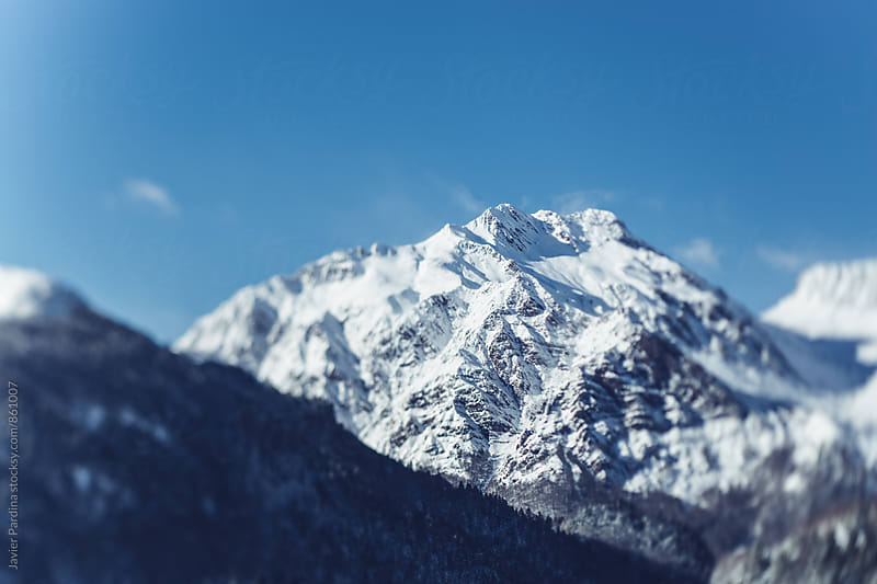 landscape with mountains and snow by Javier Pardina for Stocksy United