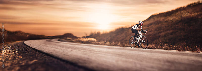 Cyclist riding alone by Anthony Chang for Stocksy United