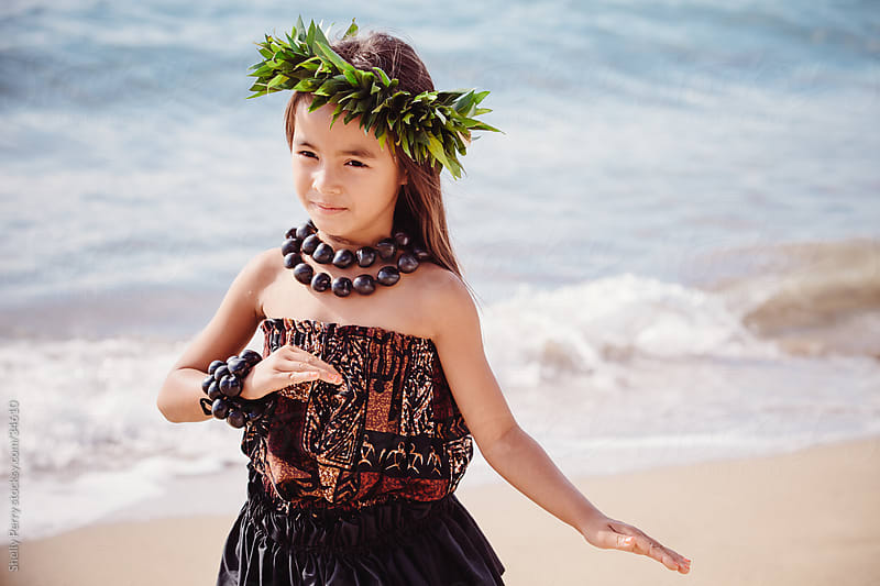 Young Girl Traditional Hawaiian Hula Dancer Performing on the Beach  by Shelly Perry for Stocksy United