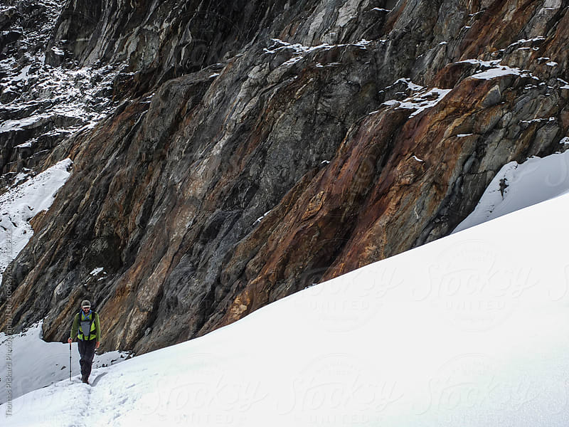 Male trekker walking on a snow covered glacier near Cho La Pass, Everest Region, Nepal. by Thomas Pickard for Stocksy United