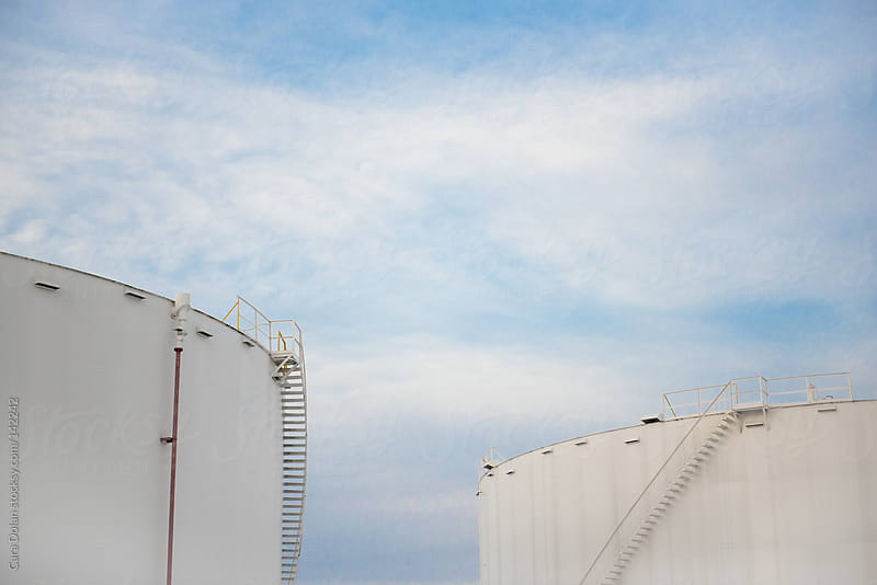 Industrial oil fuel storage tanks by Cara Dolan for Stocksy United