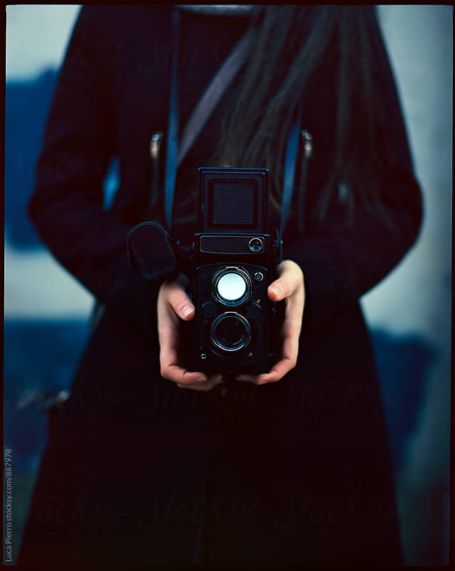 Woman hands holding vintage camera outdoors by Luca Pierro for Stocksy United