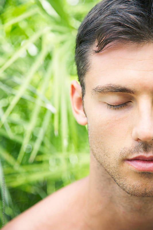 Close-up of man meditating in nature by Trinette Reed for Stocksy United