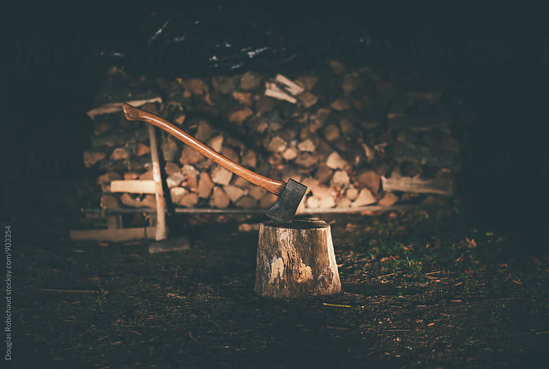 Axe chopping fire wood in the winter by Douglas Robichaud for Stocksy United