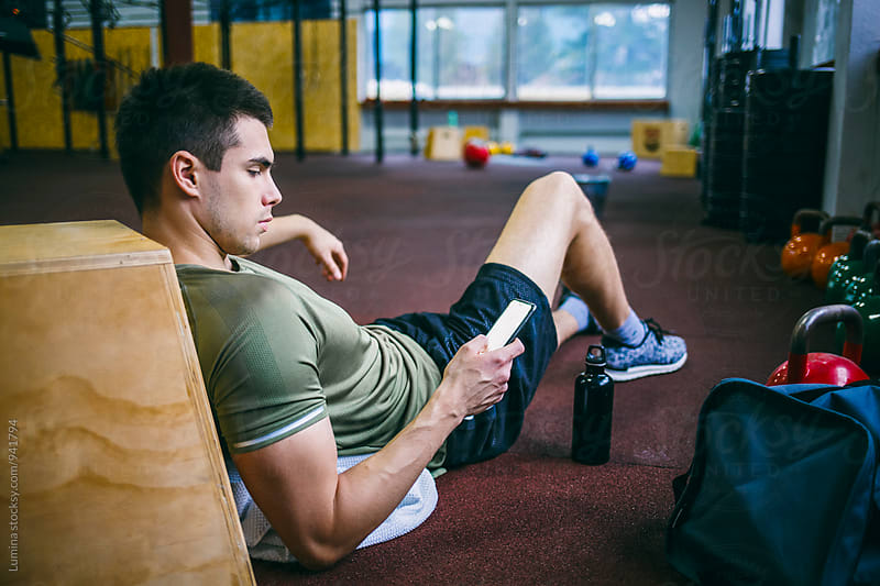 Sporty Man Lying on the Floor after the Workout by Lumina for Stocksy United