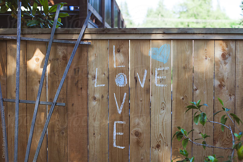 Love is written on the wall. by Cherish Bryck for Stocksy United
