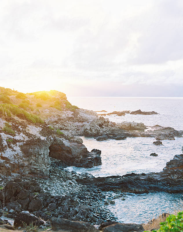 hawaii scenery and sunset over cliffs and ocean on film by wendy laurel for Stocksy United