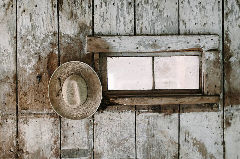 Cowboy Hat in the Barn by Raymond Forbes LLC for Stocksy United