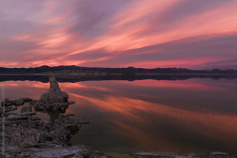 Ancient Tufa Formations with Vibrant Sunset and Reflection  by MEGHAN PINSONNEAULT for Stocksy United