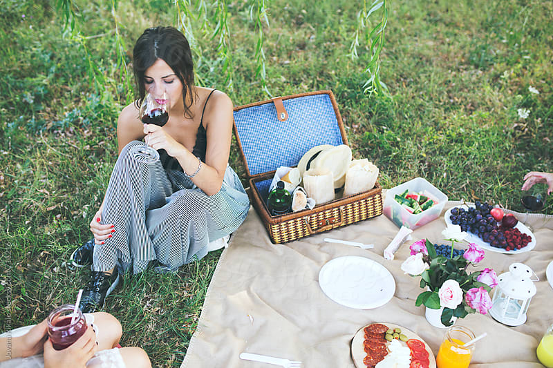 Female Friends Having Picnic In Nature by Jovana Rikalo for Stocksy United