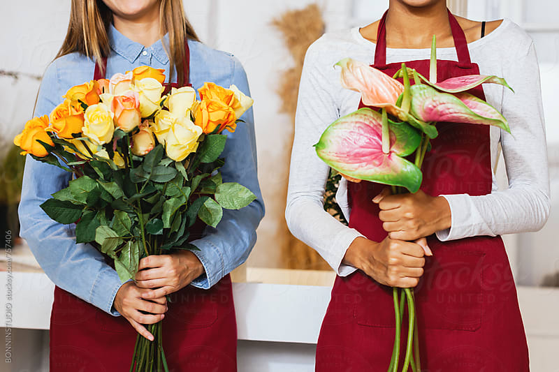 Florists holding a bouquet of flowers. by BONNINSTUDIO for Stocksy United