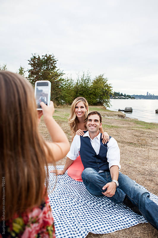 Daughter taking a picture of her parents by Suprijono Suharjoto for Stocksy United