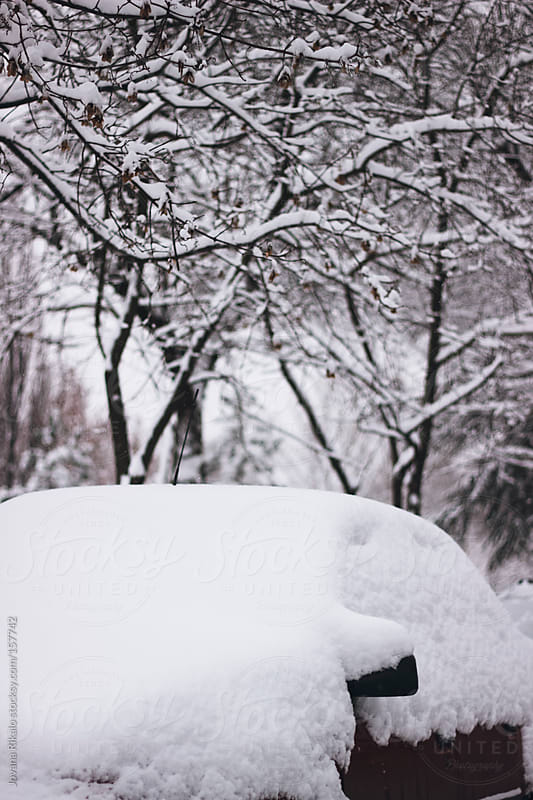Car covered with snow during winter by Jovana Rikalo for Stocksy United