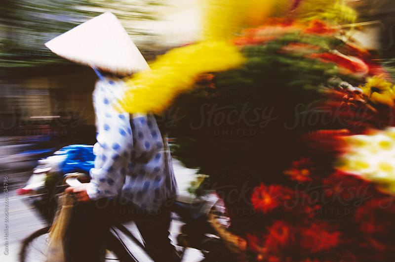 Woman selling flowers off her bicycle, Hanoi, Vietnam, Indochina, Asia  by Gavin Hellier for Stocksy United