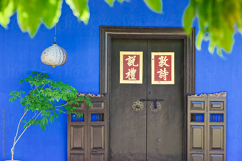 Asia, Malaysia, Penang, (Pulau Pinang), Georgetown, Chinatown district, detail of Chinese paper lantern and doorway set against a blue painted wall by Gavin Hellier for Stocksy United