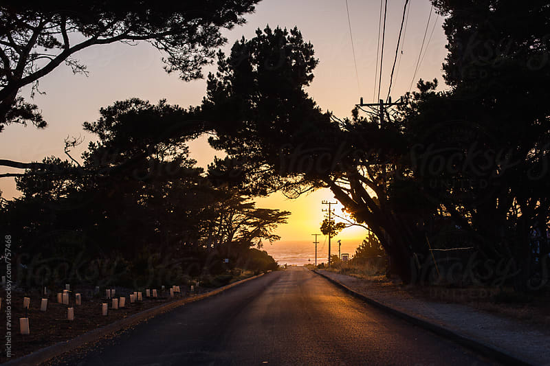 Road leading to the Pacific Ocean at sunset by michela ravasio for Stocksy United