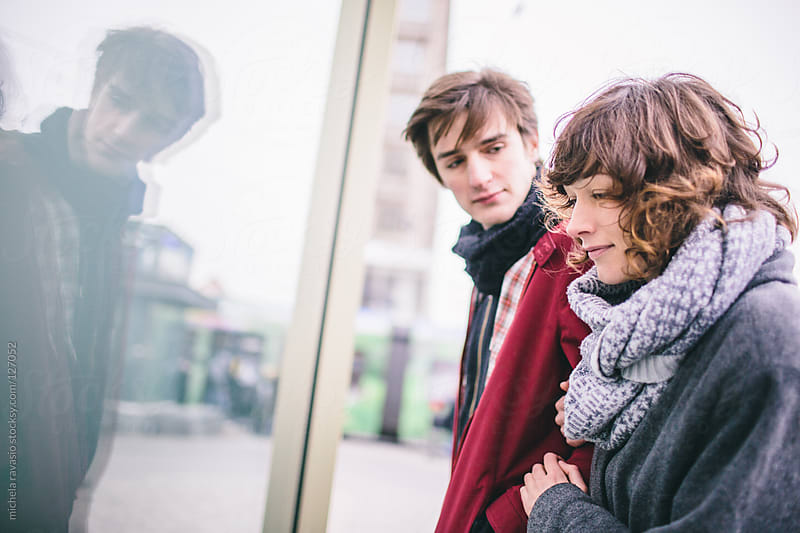 Young couple looking at window shopping. by michela ravasio for Stocksy United
