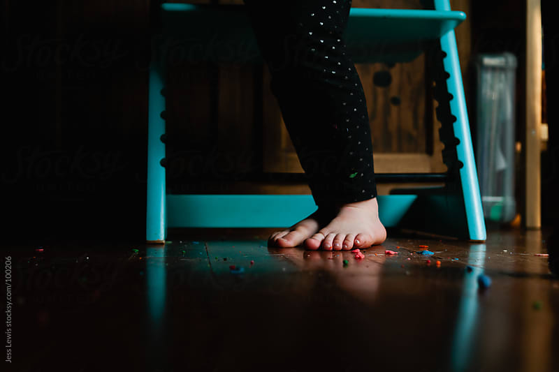 child's feet among a mess of play dough by Jess Lewis for Stocksy United