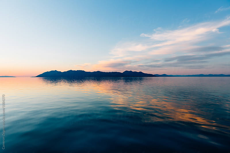sunset near Ketchikan, Alaska by Cameron Zegers for Stocksy United