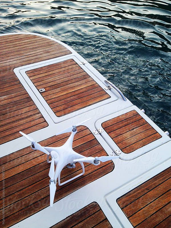Drone on a yacht by Marko Milovanović for Stocksy United