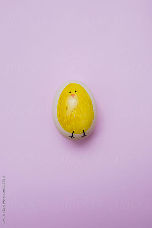 Decorated Easter egg on a pink background by Jovana Rikalo for Stocksy United