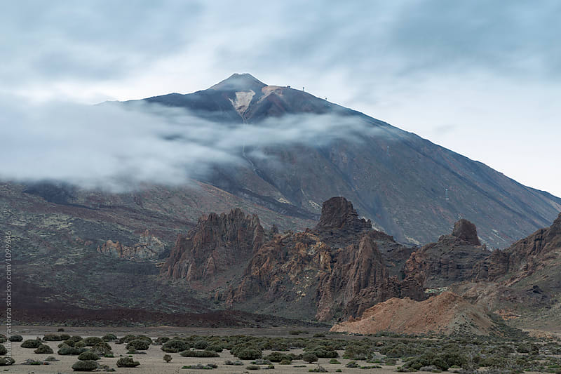 Semi-Desert landscape with Teide peak covered by clouds by Marilar Irastorza for Stocksy United