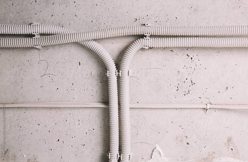 grey background with cables  by Alexey Kuzma for Stocksy United
