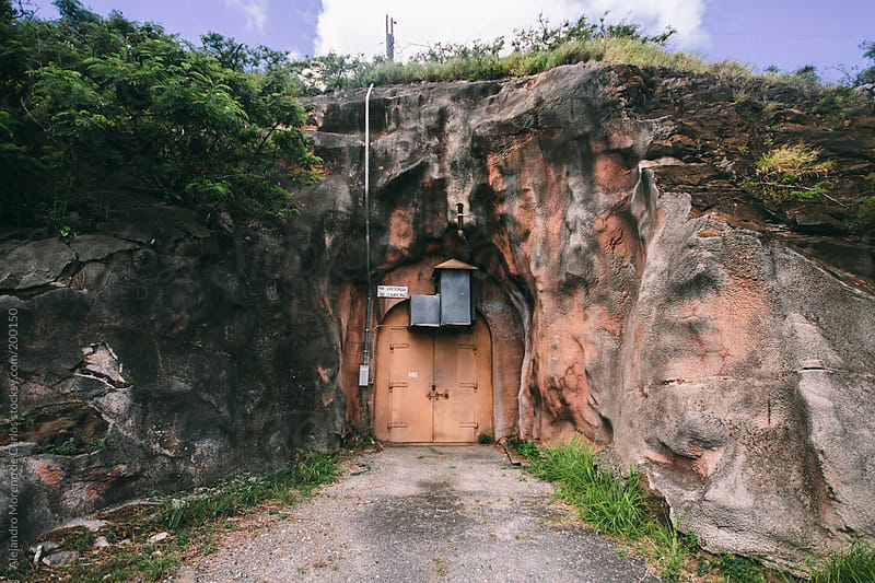 Door on the mountain - Secret hangar door by Alejandro Moreno de Carlos for Stocksy United