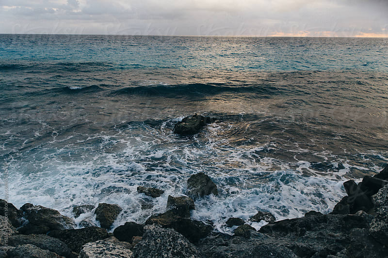 Rocky beach with waves on the Mexican coast by Christian Gideon for Stocksy United