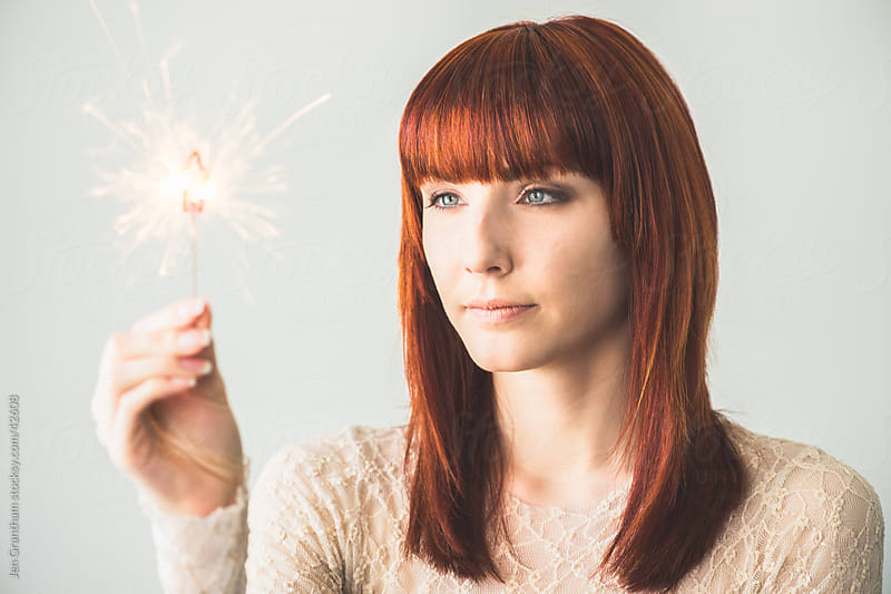 Woman with Sparkler by Jen Grantham for Stocksy United