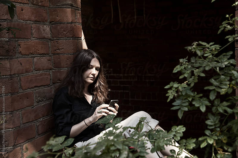 Woman with smartphone by Nicolai Perjesi Photography for Stocksy United