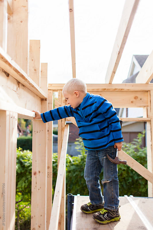 Little Boy Training for Career in the Trades as Carpenter by JP Danko for Stocksy United