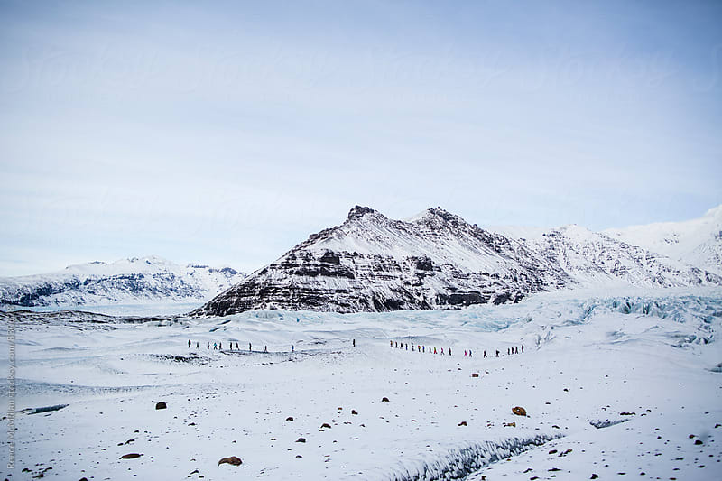 Group hike on a glacier by Reece McMillan for Stocksy United