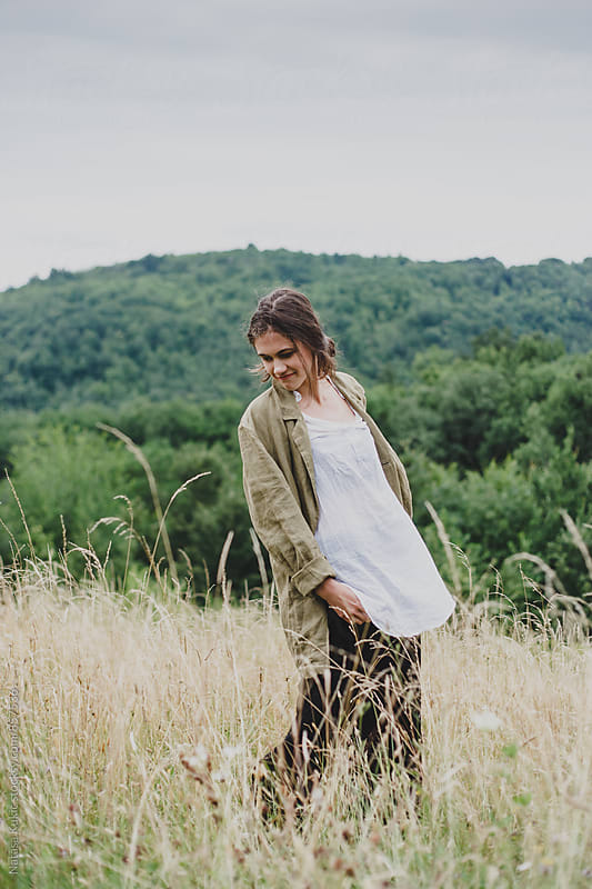 Outdoor portraits of a beautiful young woman by Natasa Kukic for Stocksy United