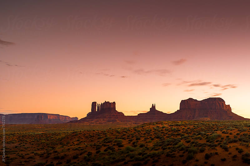 Monument Valley Utah USA Landscape At Dusk Under Colorful Tobacco Sky by JP Danko for Stocksy United